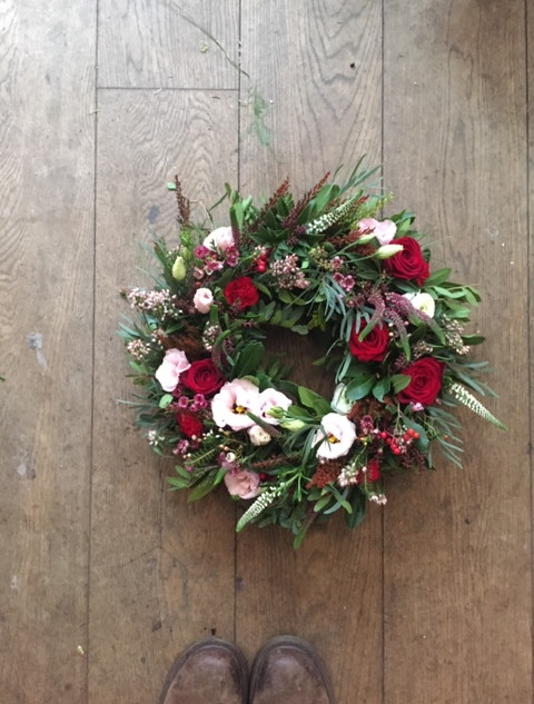 wreath in reds and pinks