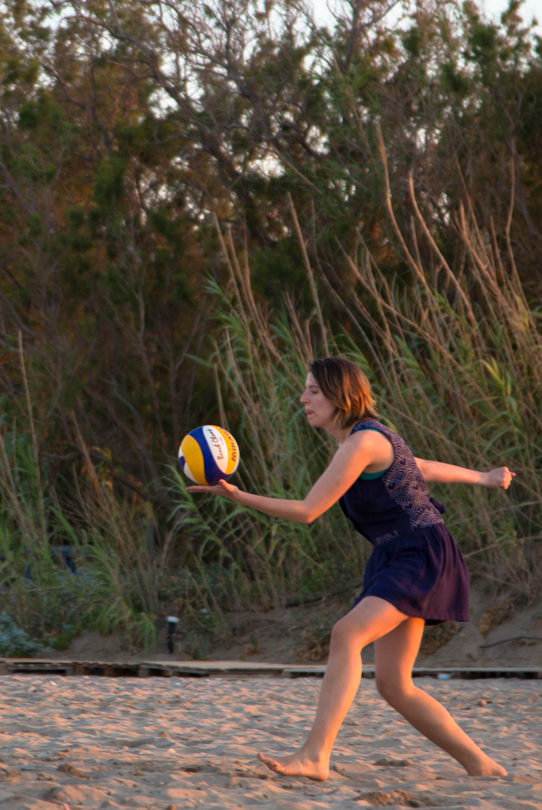 A young girl playing volleyball