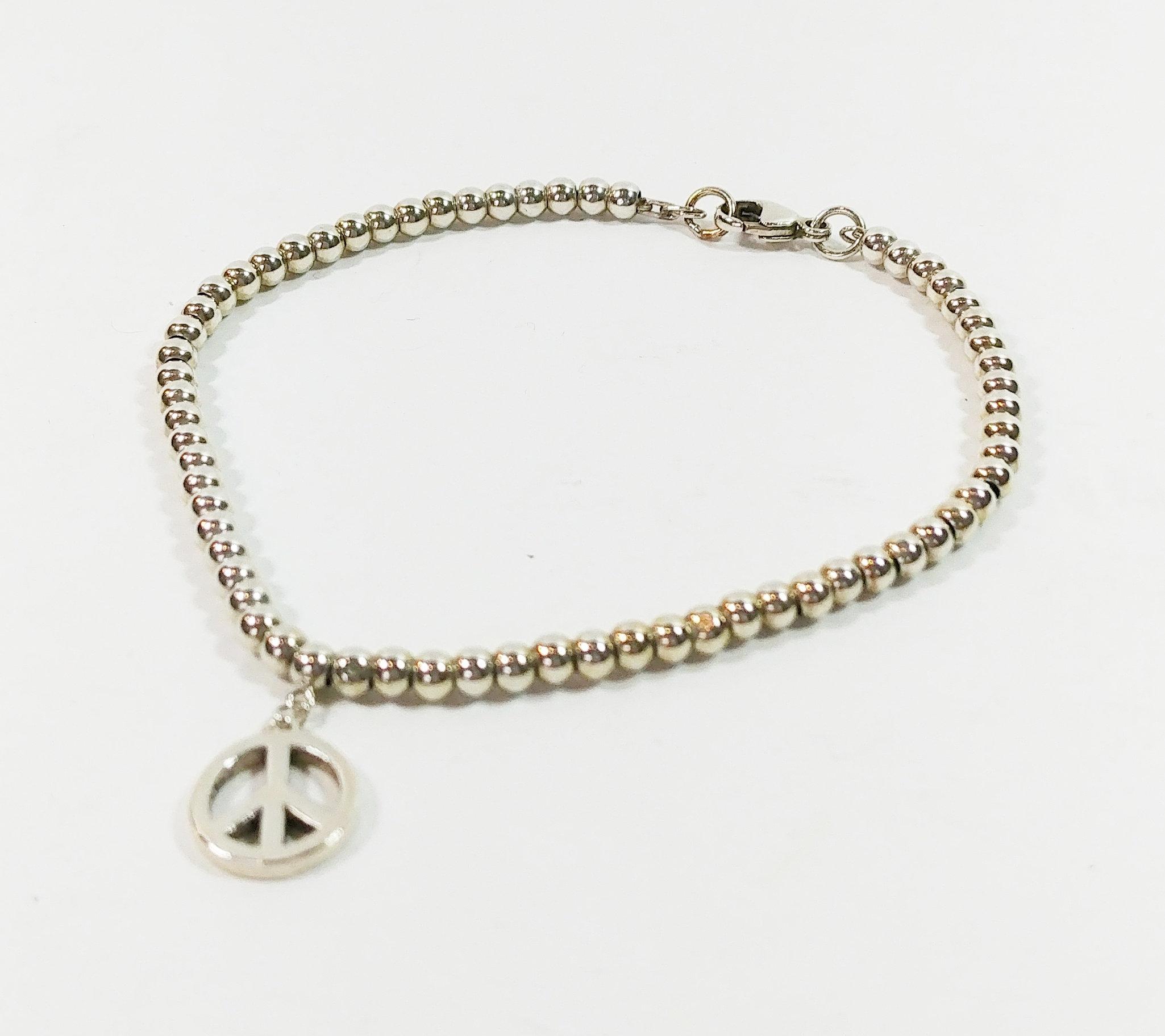 f8bd435b832fa Tiffany & Co. Beads Bracelet Small Peace Sign | hazelilly