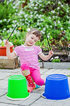 Little girl having fun in the summer gar