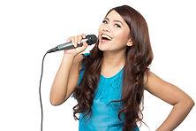 beautiful stylish woman singing karaoke