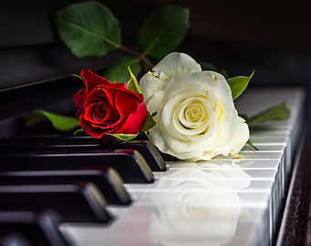 A piano keyboard with roses on it.