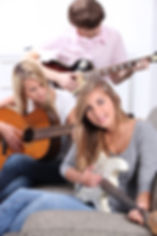 Young people playing guitars_edited.jpg