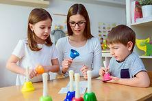 Teacher and Preschool Children in Music