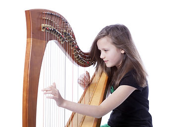 A little girl playing the harp.
