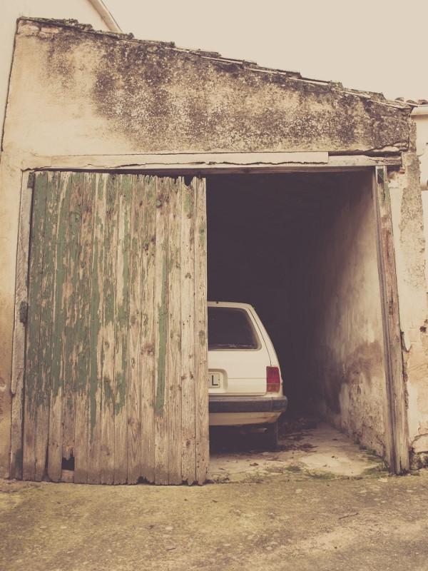 Car stuck behind garage door that won't open.
