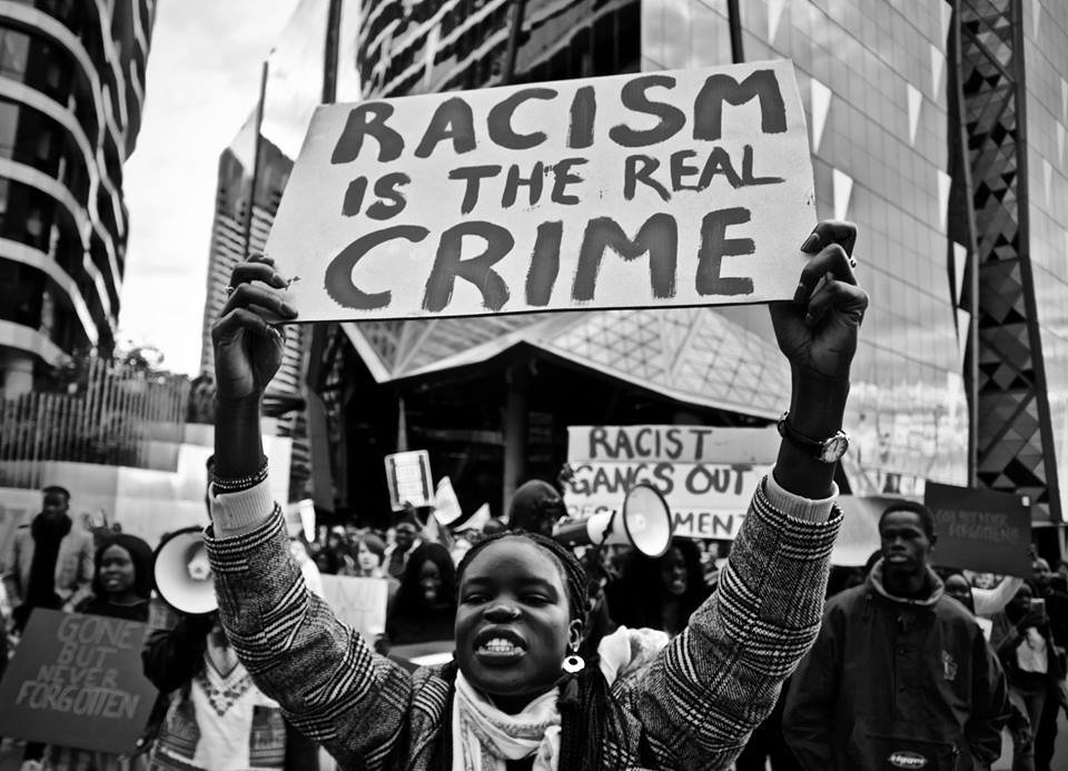 Racism is the Real Crime Sign.jpg