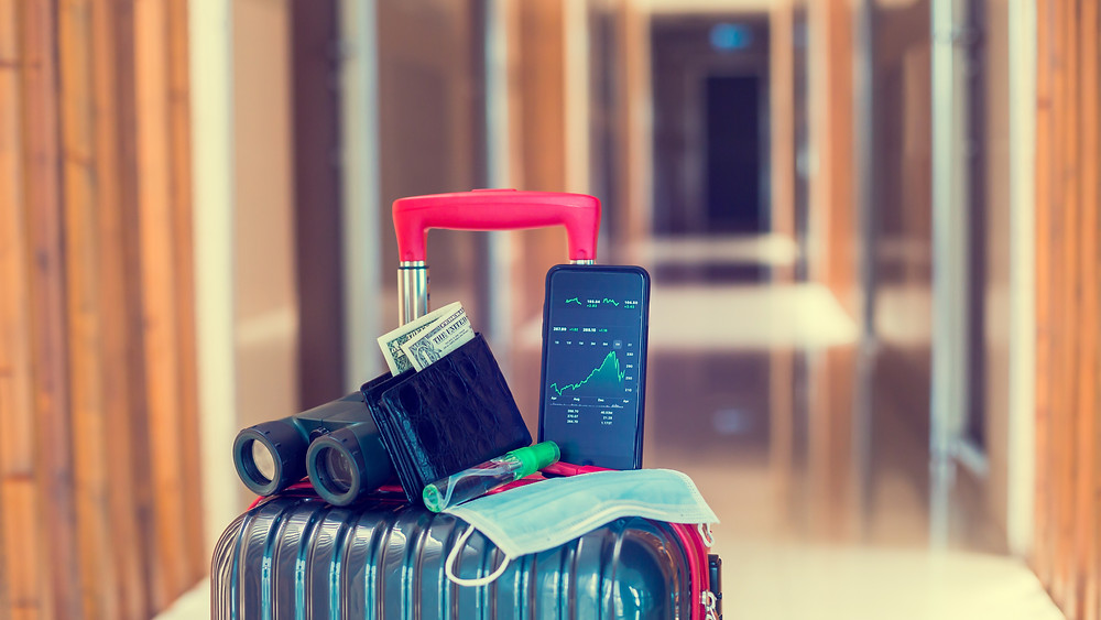 going holidays during pandemia - phone, mask, money, luggage