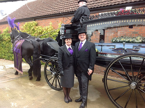 photograph of mark forth and sue forth standing next to and open horse-drawn funeral carriage