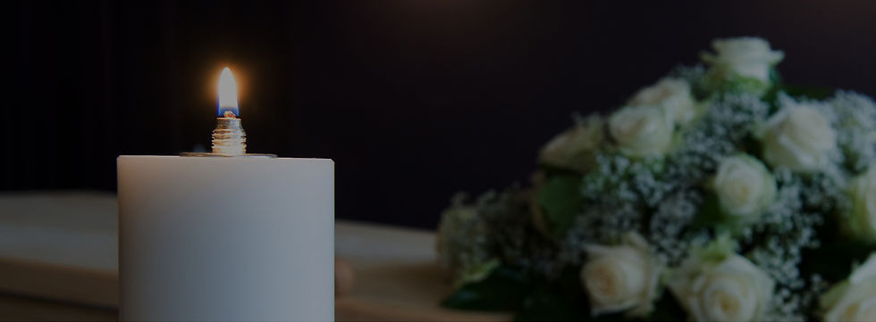 photograph showing candle near coffin with flowers at a Mark Forth independent funeral services
