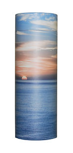 photograph of funeral cremation ashes scatter tube ocean sunset scene design mark forth