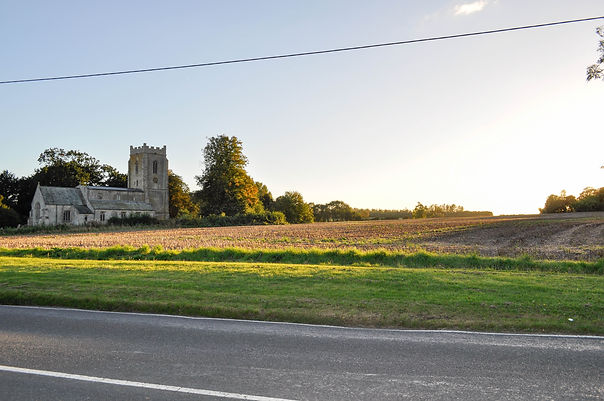 photograph of Lincolnshire church and churchyard with the sunsetting over field next to a Mark Forth independent funeral service