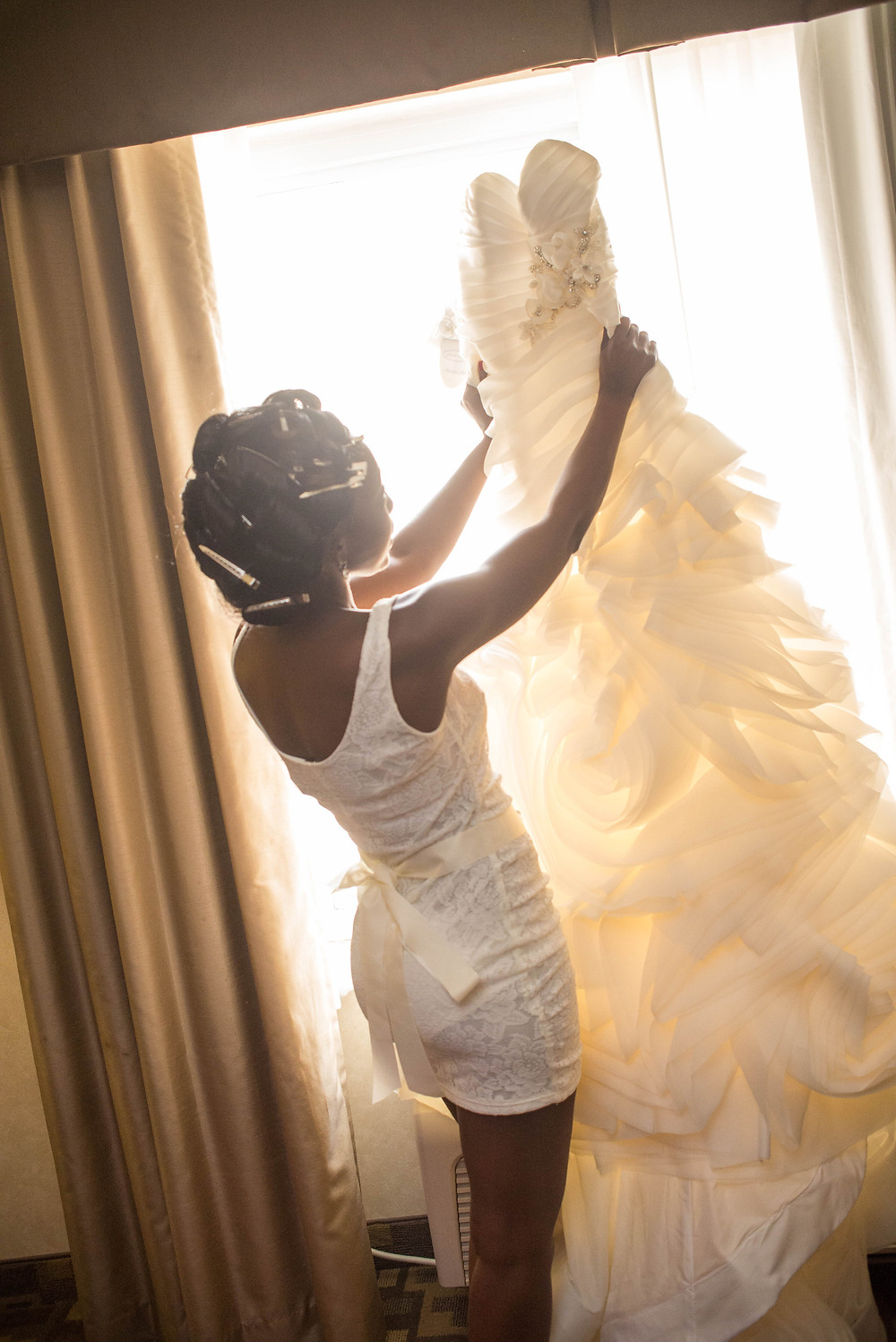 Me looking at my wedding gown.