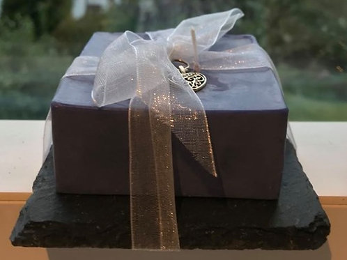 100% eco soy wax square candle on slate tile.
