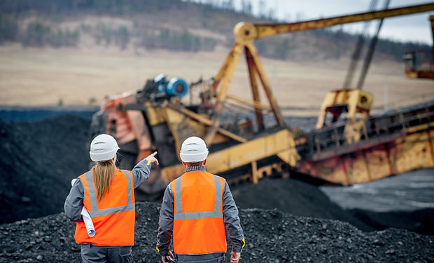 Coal mine workers in an open pit.jpg