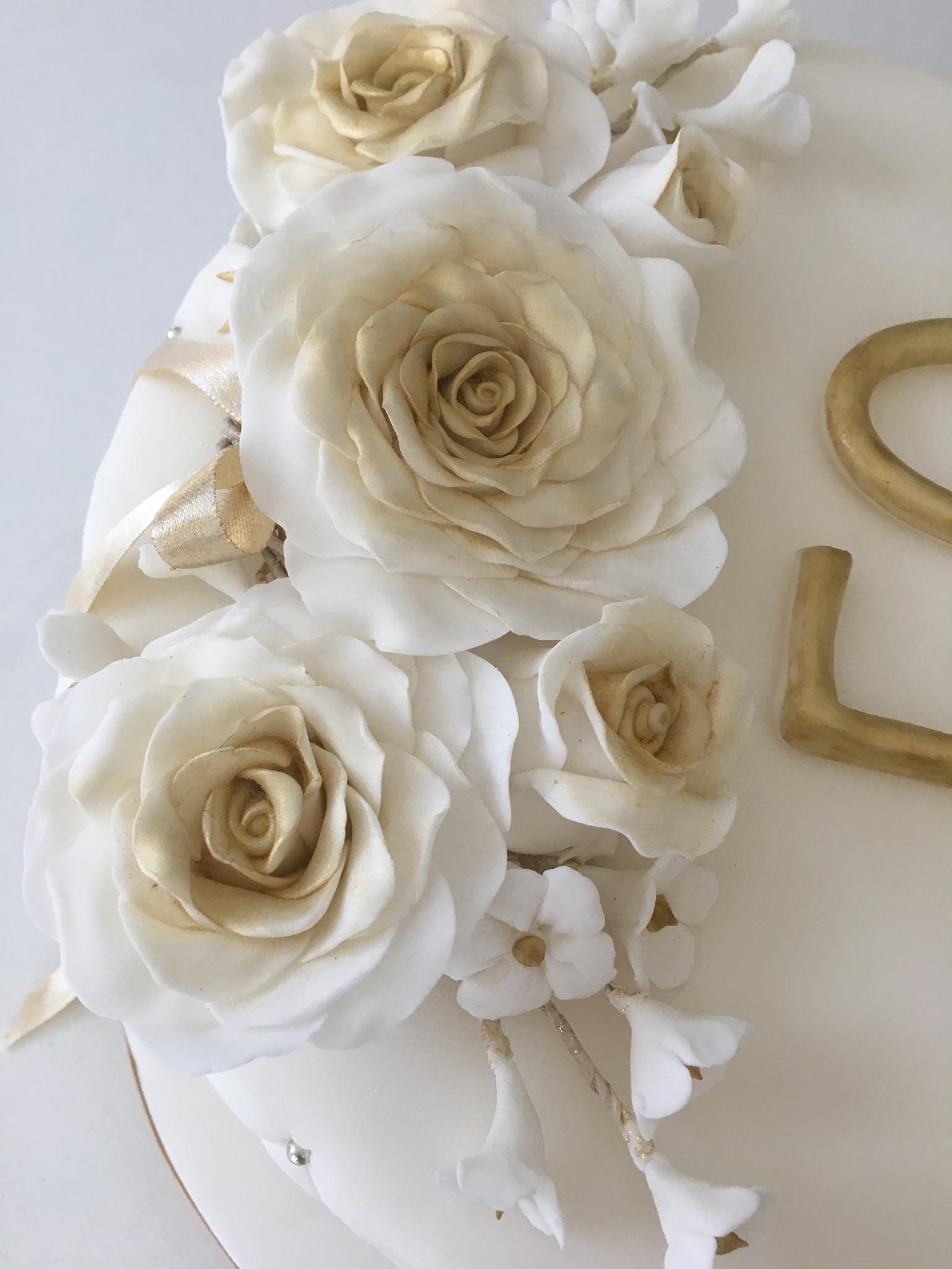 Elegant gold floral wedding anniversary cake