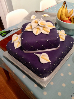 Purple and peace lily wedding cake