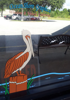 Sammy's Pelican on window.jpg