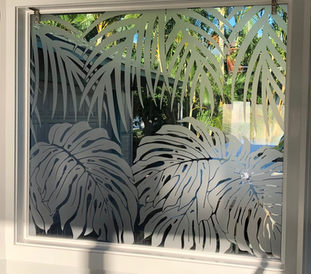 Plants and Palm Leaves on window.jpg