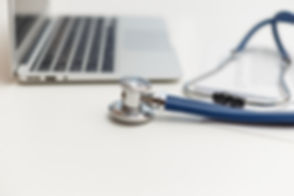 stethoscope-and-laptop-on-doctor-working