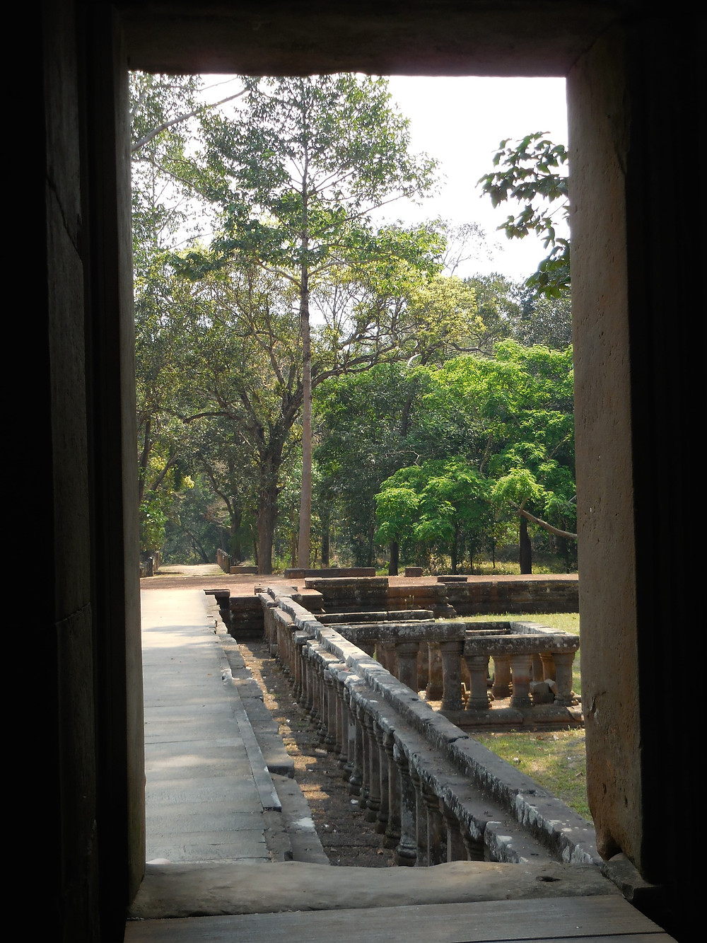 Looking through a doorway to the outdoor walkway at Chau Say Tevoda