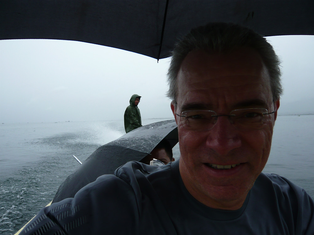 Crossing Inle Lake during a driving rainstorm