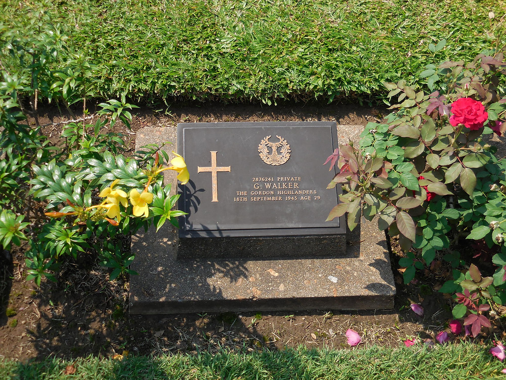 A grave marker for a British POW who is buried at Don-Rak war cemetery