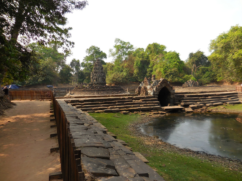 Neak Pean is known as the island temple since it sits in the middle of one of the barays (small lakes) of the Khmer empire