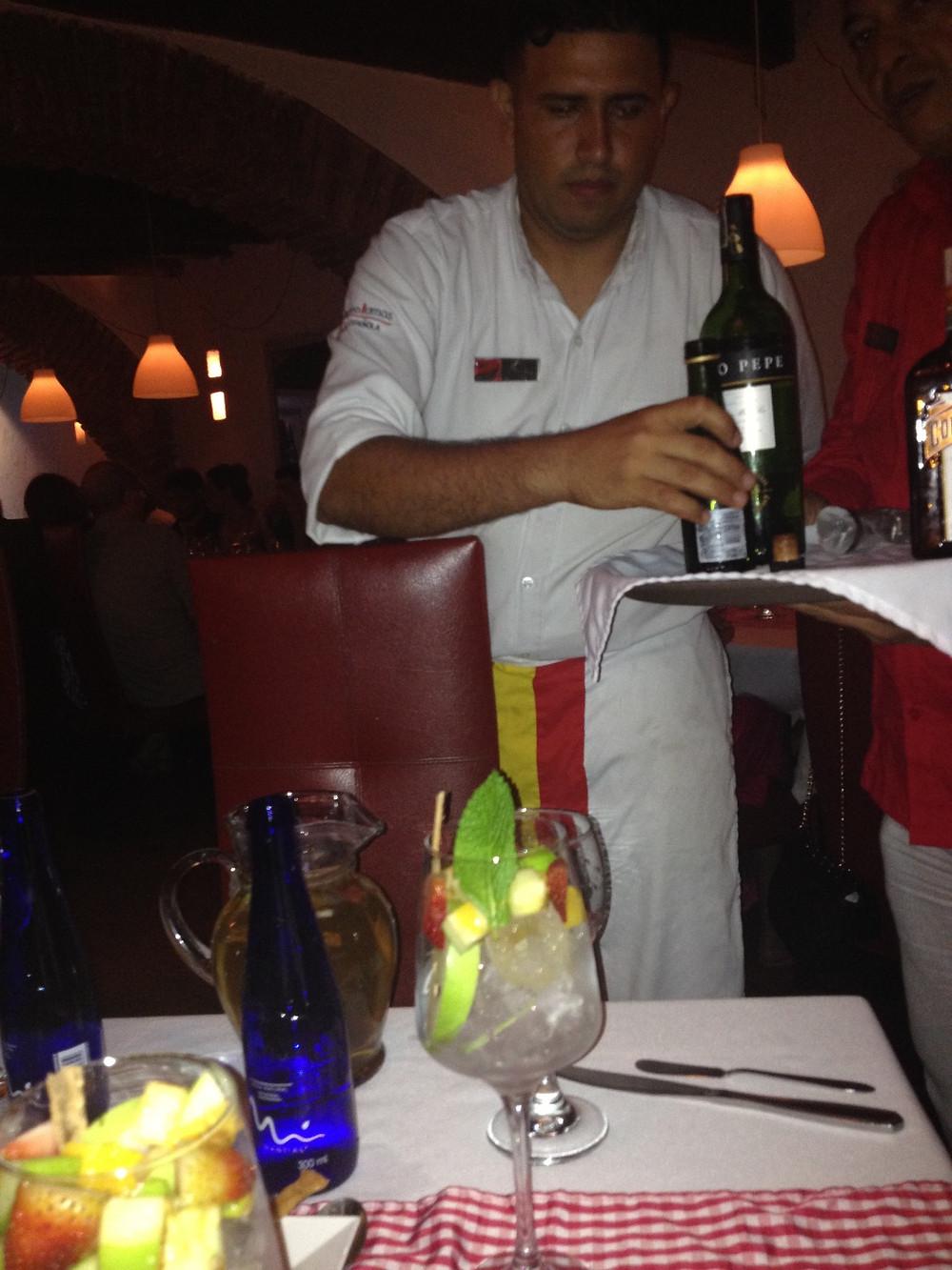 Our server at El Burlador de Sevilla is preparing to make a refreshing white Sangria