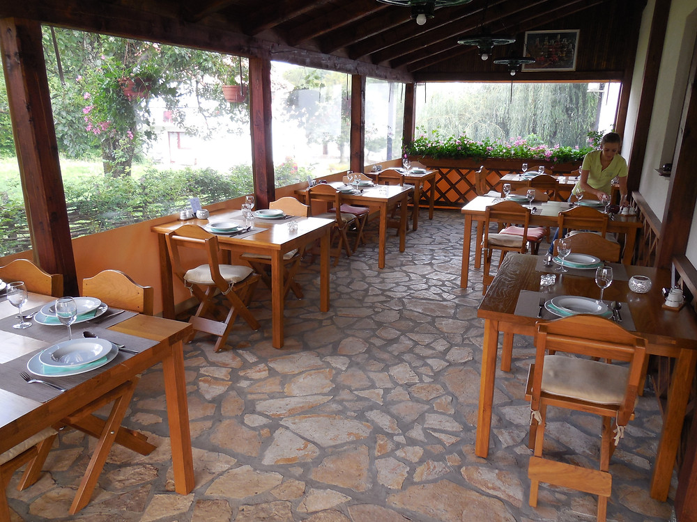 The enclosed outside dining area provides a great atmosphere for summer dinner