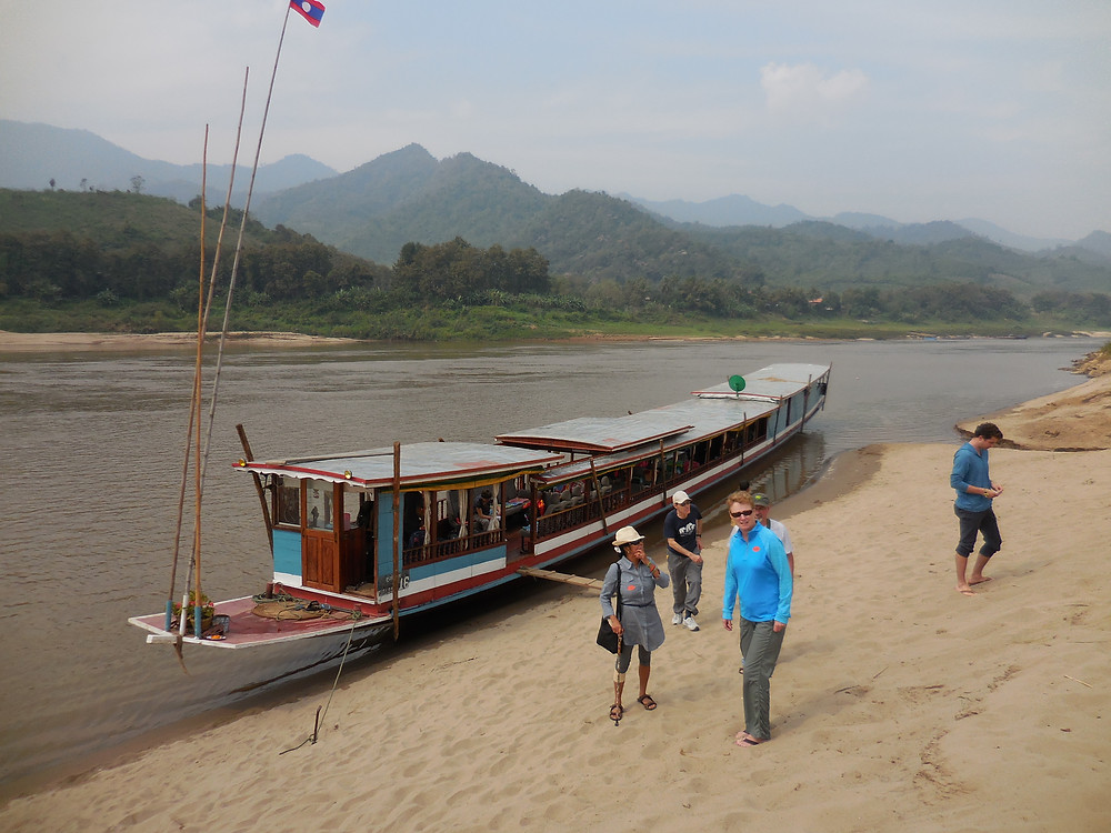 Our boat docked along the Mekong at a local village