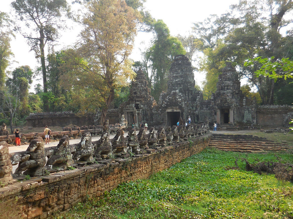 The causeway leading to the gopura is similar to the south gate of Angkor Thom
