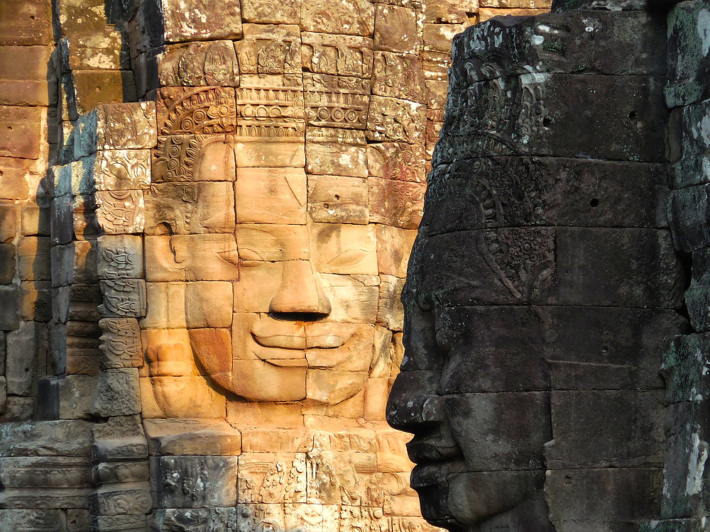 The stone faces of Bayon. This photo was taken in the late afternoon sun.