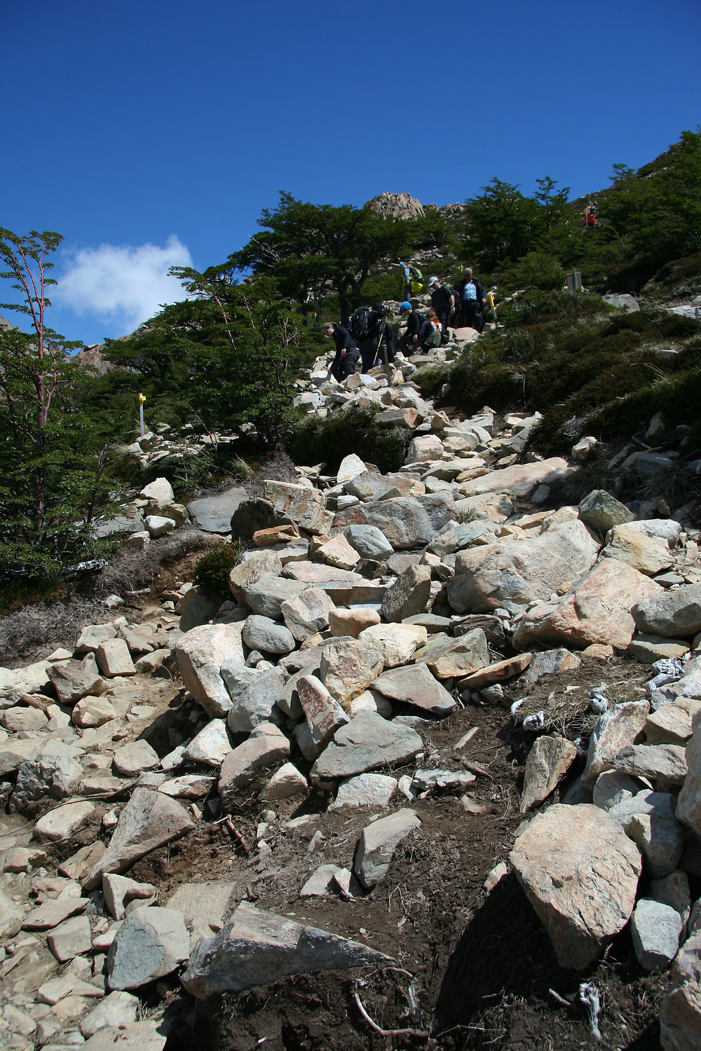The steep climb up the last mountain is full of rocks and boulders that you have to navigate around