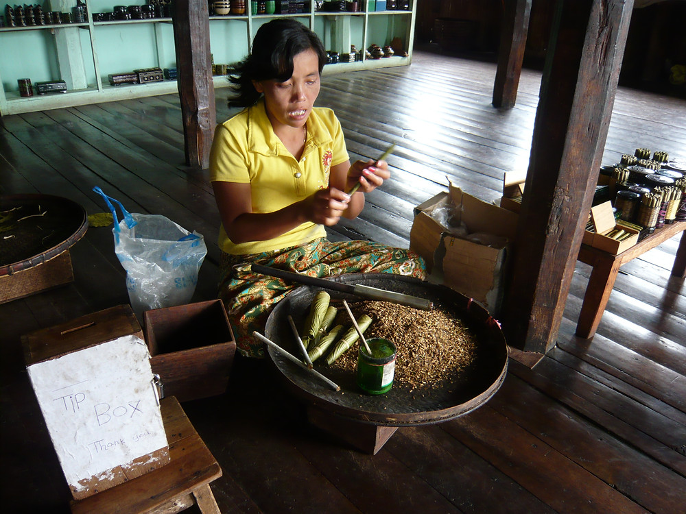 Woman making cheroots (cigars)