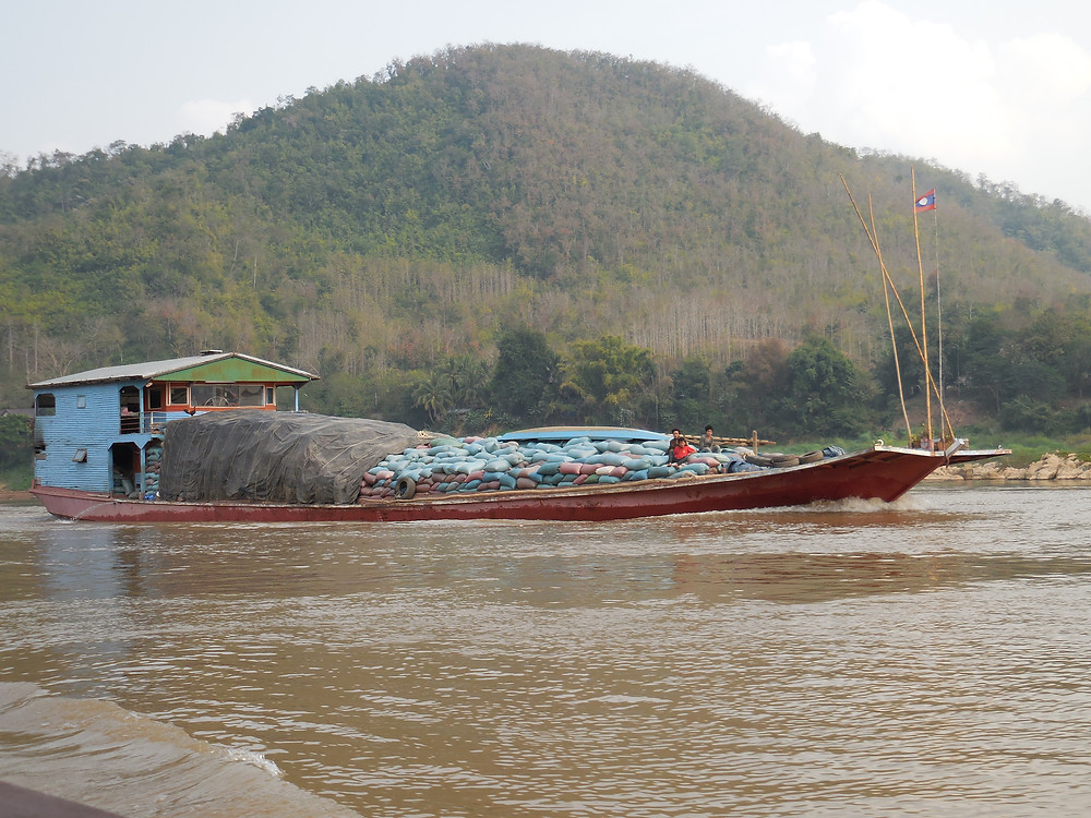 One of the barges carrying rice on the Mekong