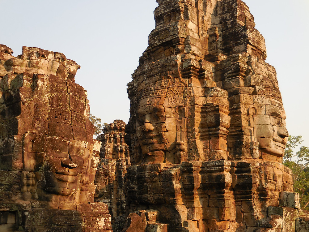 The stone faces of Bayon in the late afternoon sun