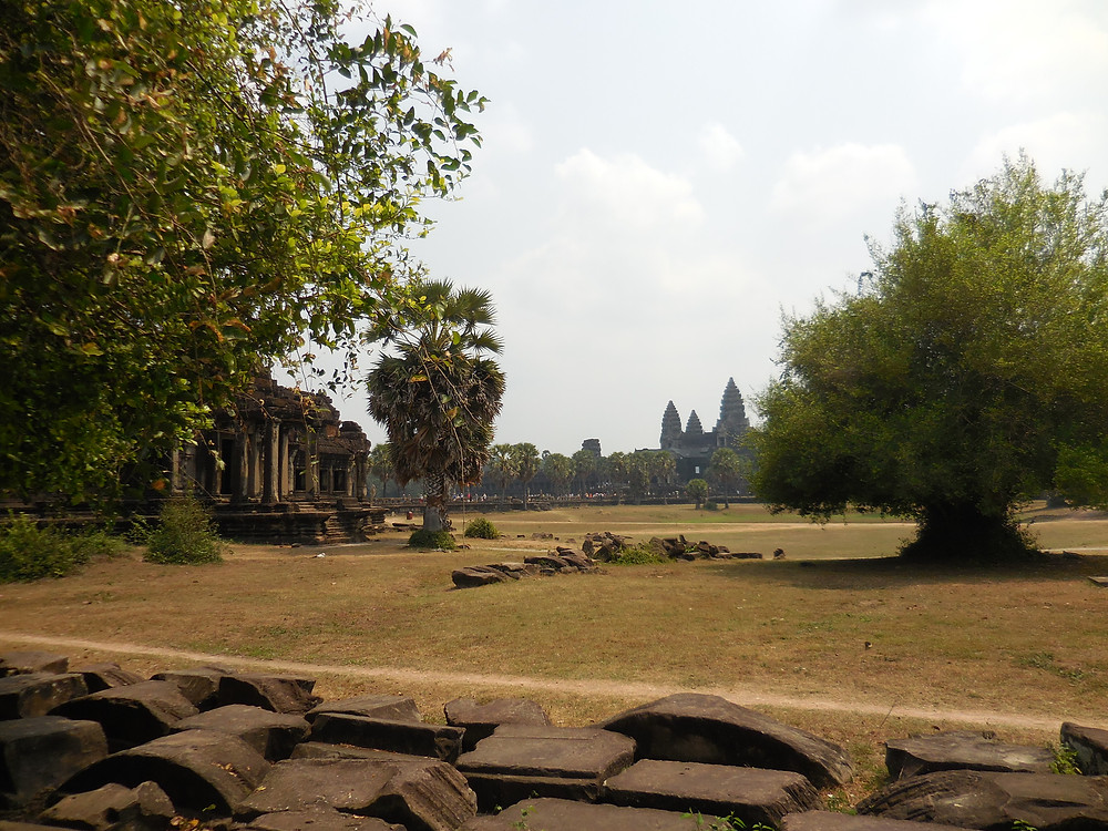 Looking across the vast interior between the outer walls and the temple of Angkor Wat. Photo taken mid-day.