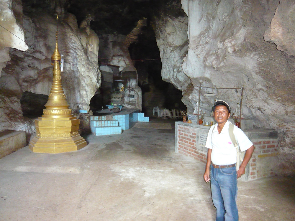 My tour guide, Htwe, standing inside the cave we came upon during our hike