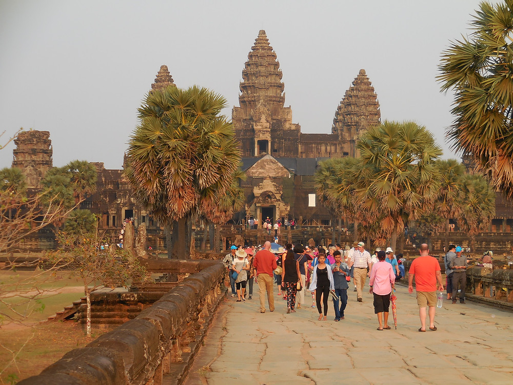 Walking down the long walkway between the outer wall and the temple at Angkor Wat in the late afternoon