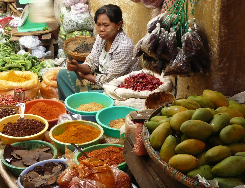 Local woman selling spices and fruits at the farmer's market in Pyin Oo Lwin