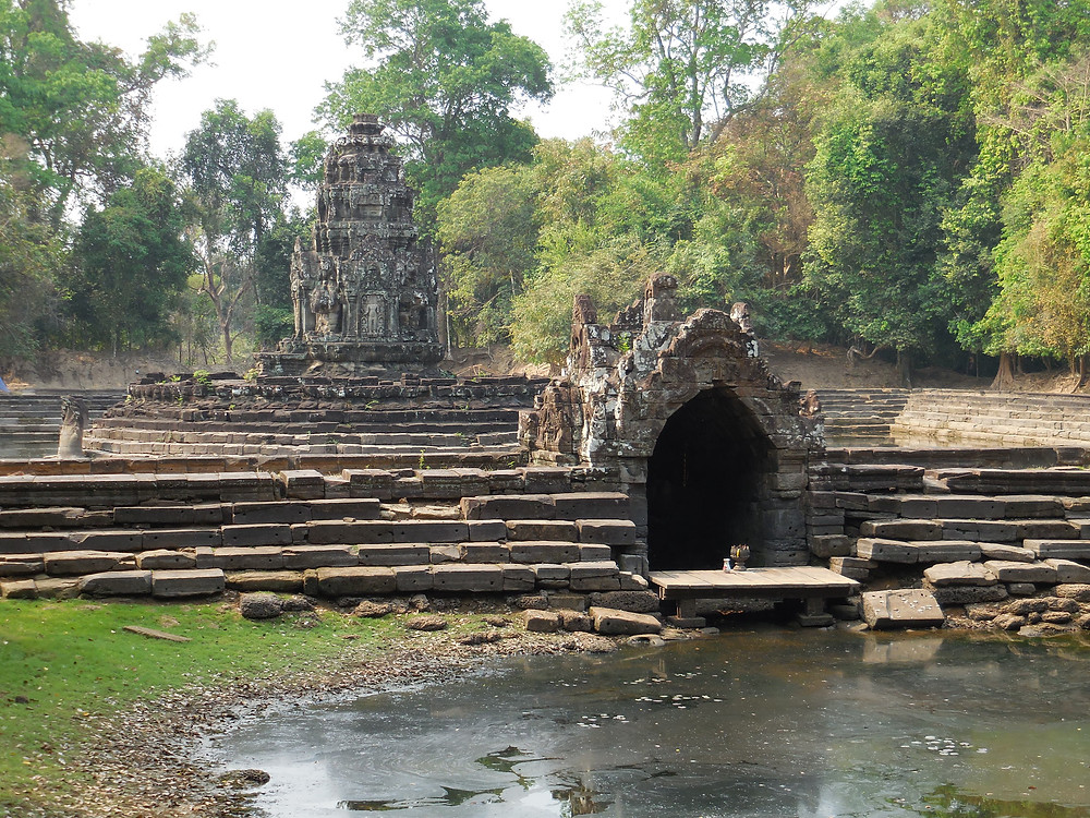 Sitting at the end of a long dirt walkway separating two sections of a baray or small lake, this is one of the most unusual temples at Angkor