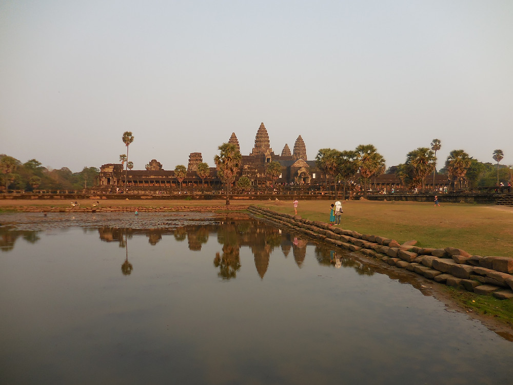 The late afternoon sun makes for a more vibrant photo of Angkor Wat as reflected in the pond in front of it