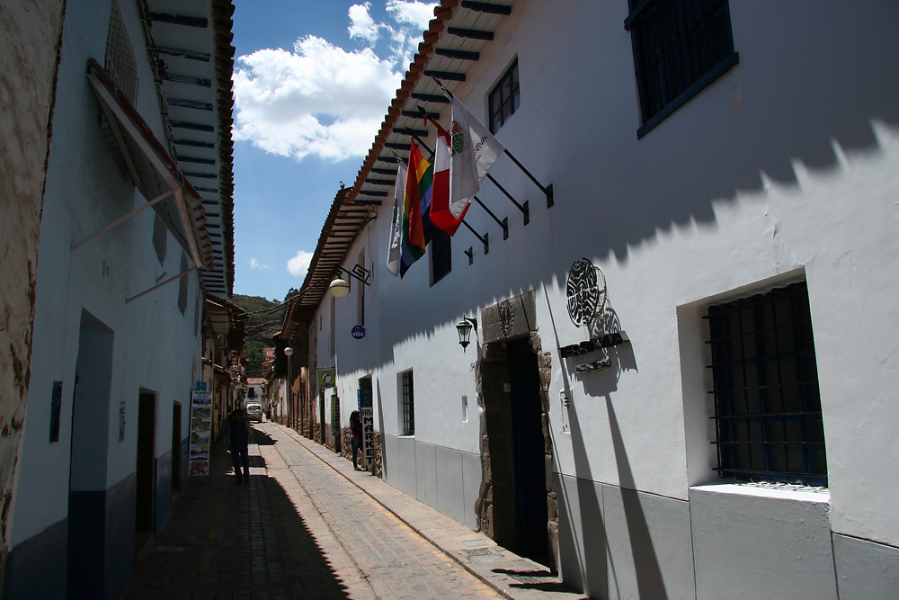 The Tierra Viva Cusco San Blas hotel, with the flags over the front door, is on a very narrow street
