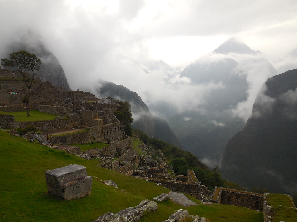 The ruins at Machu Picchu with a stunning cloud cover shrouding the mountains behind