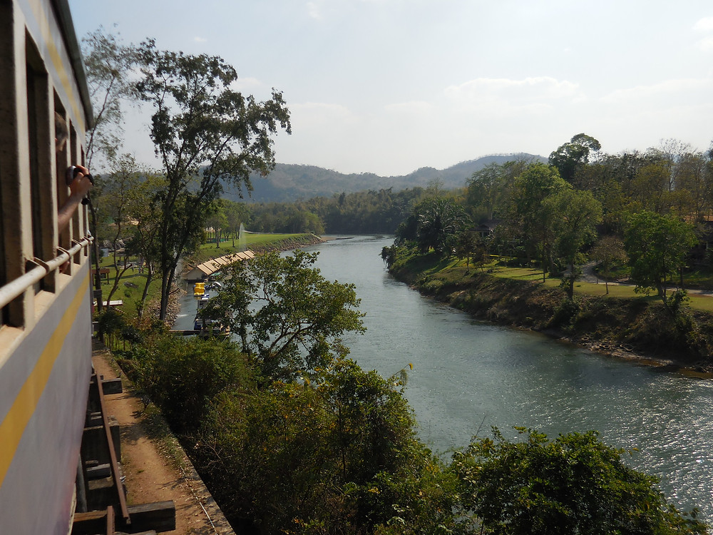 Riding the Death Railway train from Nam Tok to the River Kwai. Near Thamkrasae Bridge, the train travels over the Wampo Viaduct – a series of wooden trestles.