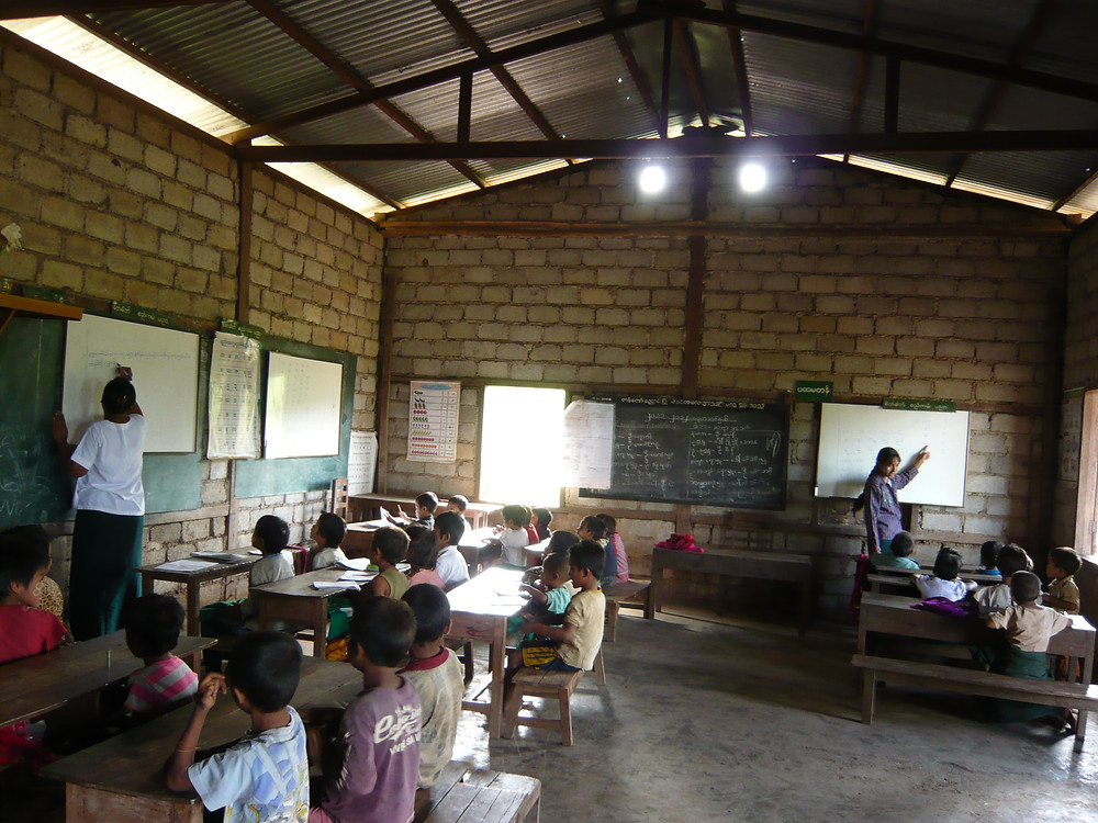 Several classes take place in the one room school house in the village near Inle Lake