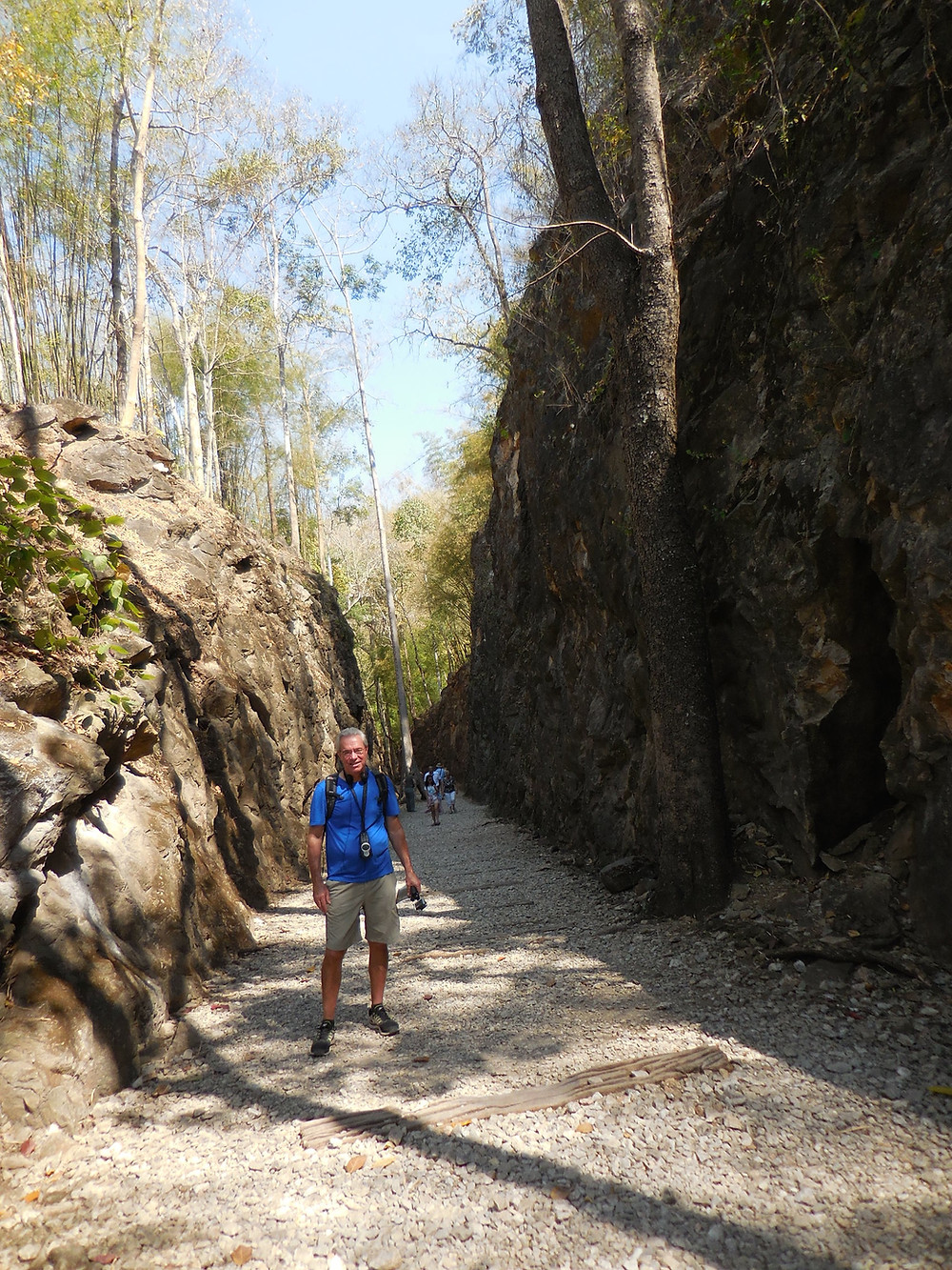 Inside Hellfire Pass. Notice how high the rock wall is on the right side.