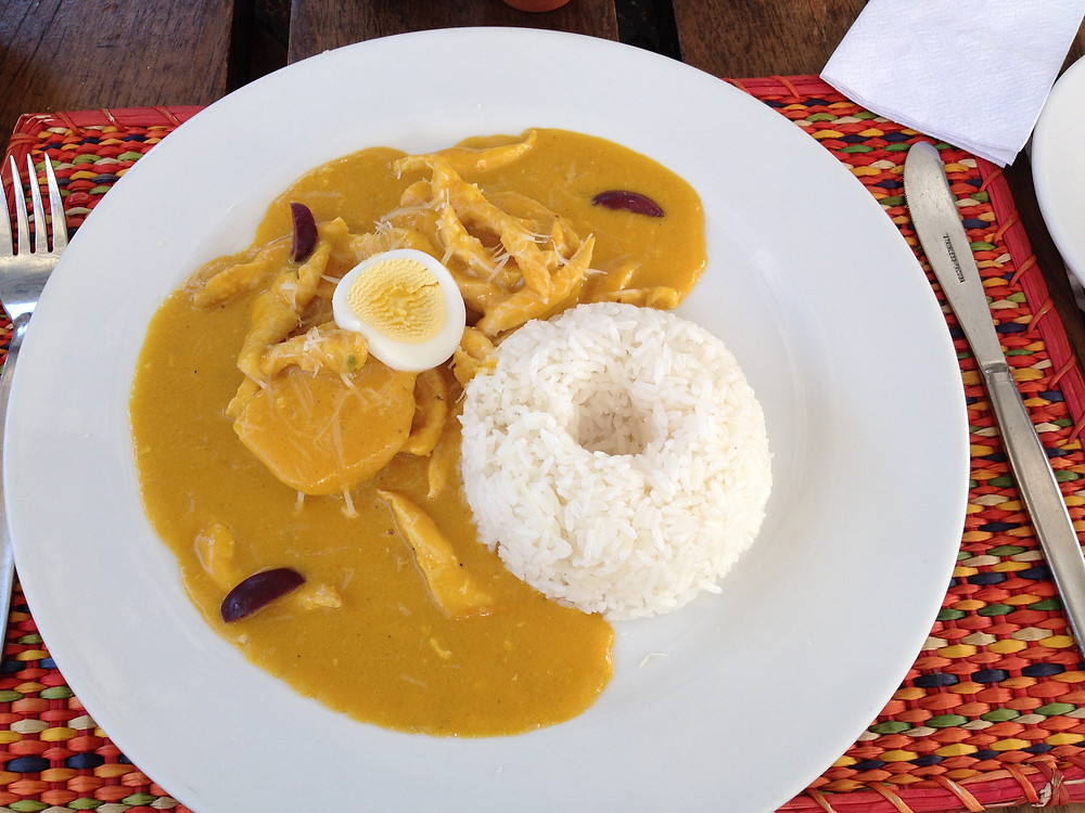 Aji de gallna is shredded chicken in a creamy yellow chili sauce with nuts and Parmesan cheese from Pacha Papa Restaurant in Cusco