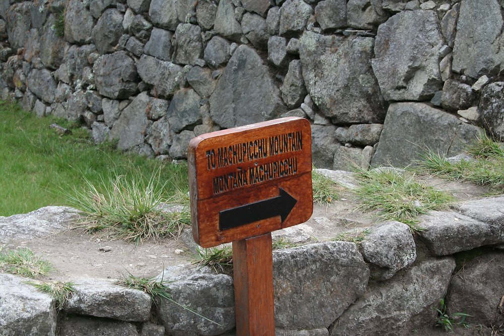 The sign shows the way to the start of the trail
